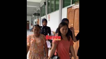 DIDAKWA: Gansau (kiri) dan Cecelia keluar dari Mahkamah Sesyen selepas dijatuhi hukuman.