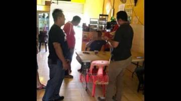 BANTERAS: Pemeriksaan polis di lokasi serbuan.