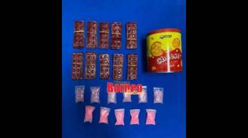 RAMPAS: Barang disyaki dadah ditemui ketika suspek ditahan dan dirampas untuk dijadikan barang bukti.