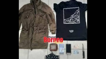 BARANG KES: Baju dan beberapa barang dirampas daripada suspek untuk siasatan kes rompakan.